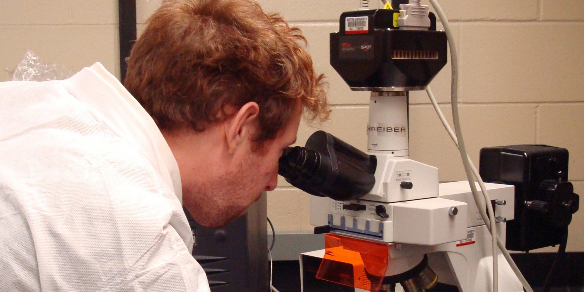 researcher_at_microscope_